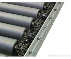 Приводной роликовый конвейер фото